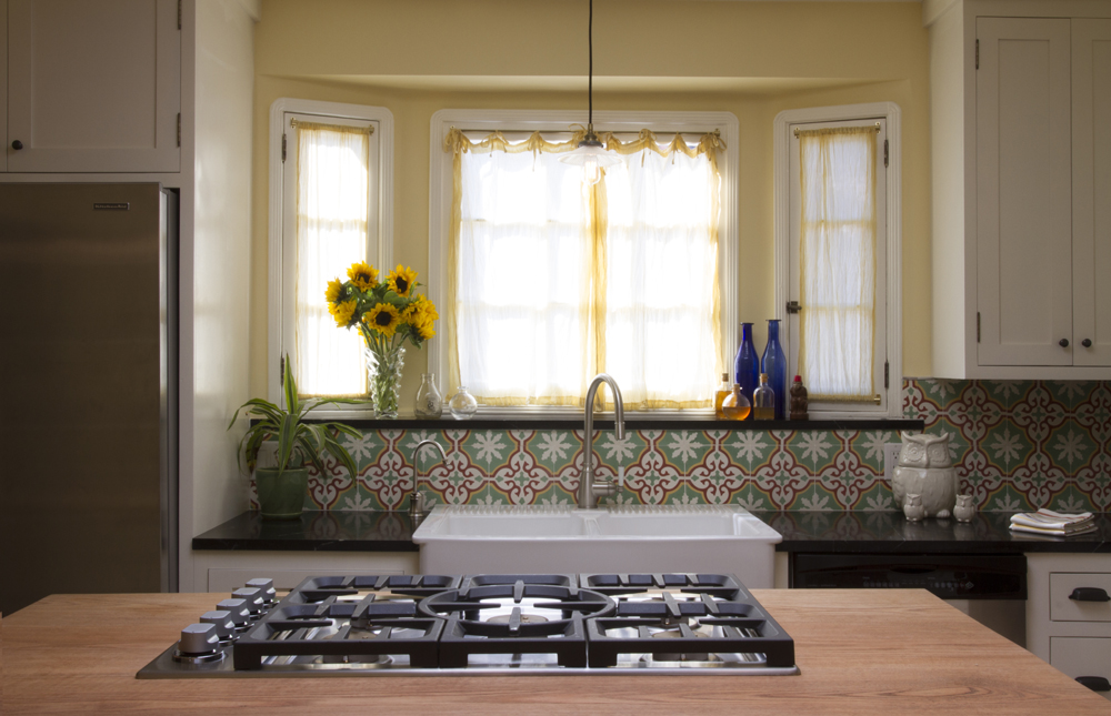 Happy kitchen with colorful cement tile backsplash