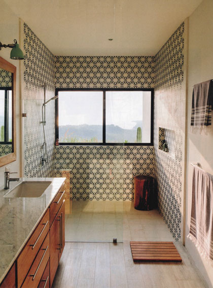Elegant bathroom with Granada Tile's star-like Tunis pattern wrapping around the 3 walls of an open shower.