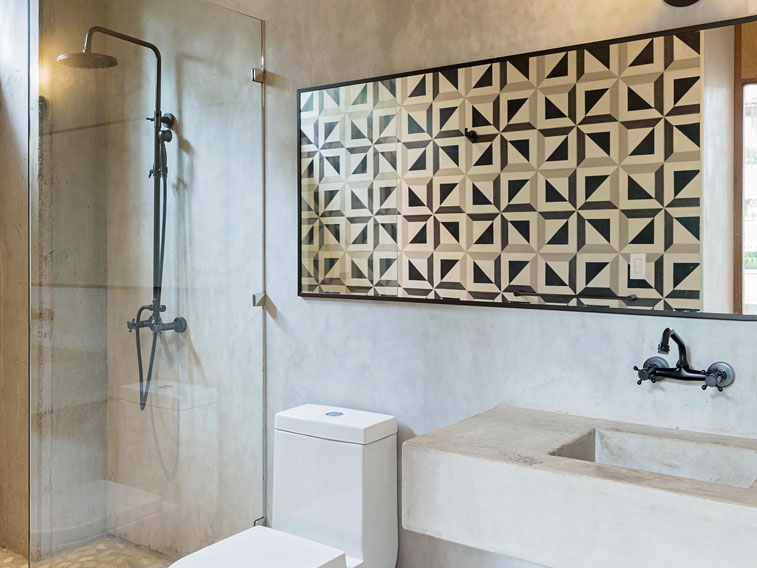 Quilt-like cement tile pattern is focal point in this beach retreat bathroom