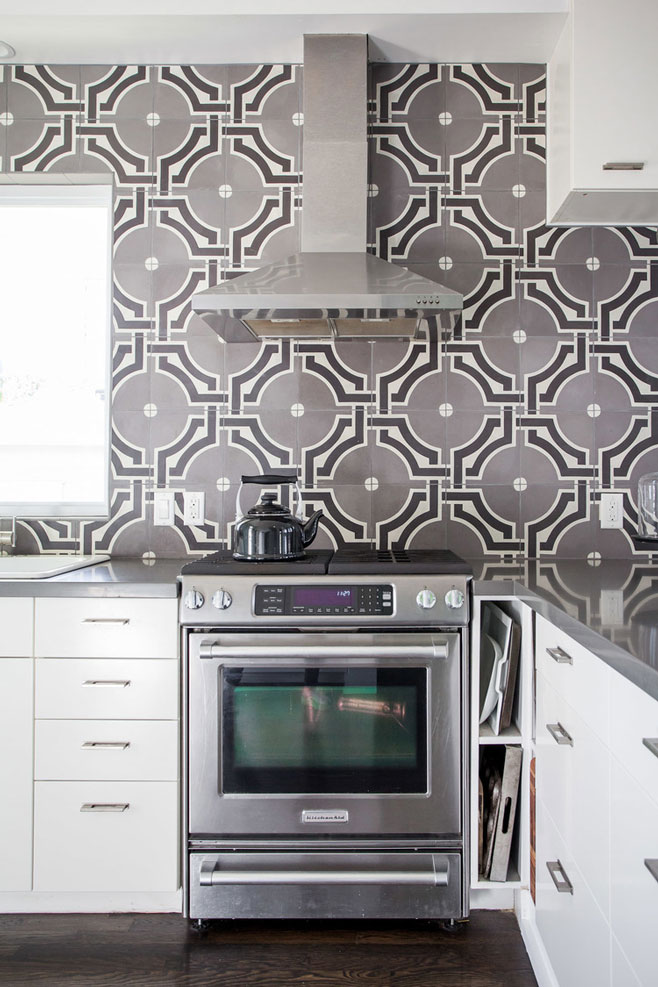 Kitchen with custom tile design in Angelina House in Austin Texas