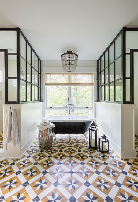 Dramatic bathroom with geometric cement tiles by Granada Tile