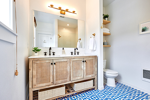 Cheerful beach bathroom with Granada Tile's geometric Moroccan style cement tiles in blue and white