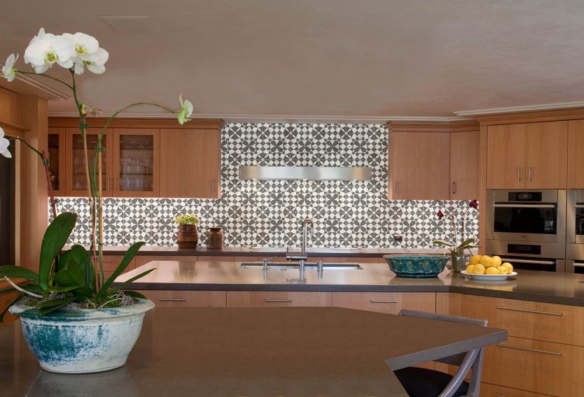 Dramatic kitchen backsplash with intricate black and white Metamorphosis tile