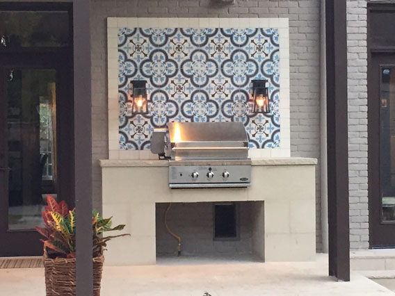 Outdoor grill concrete tile backsplash