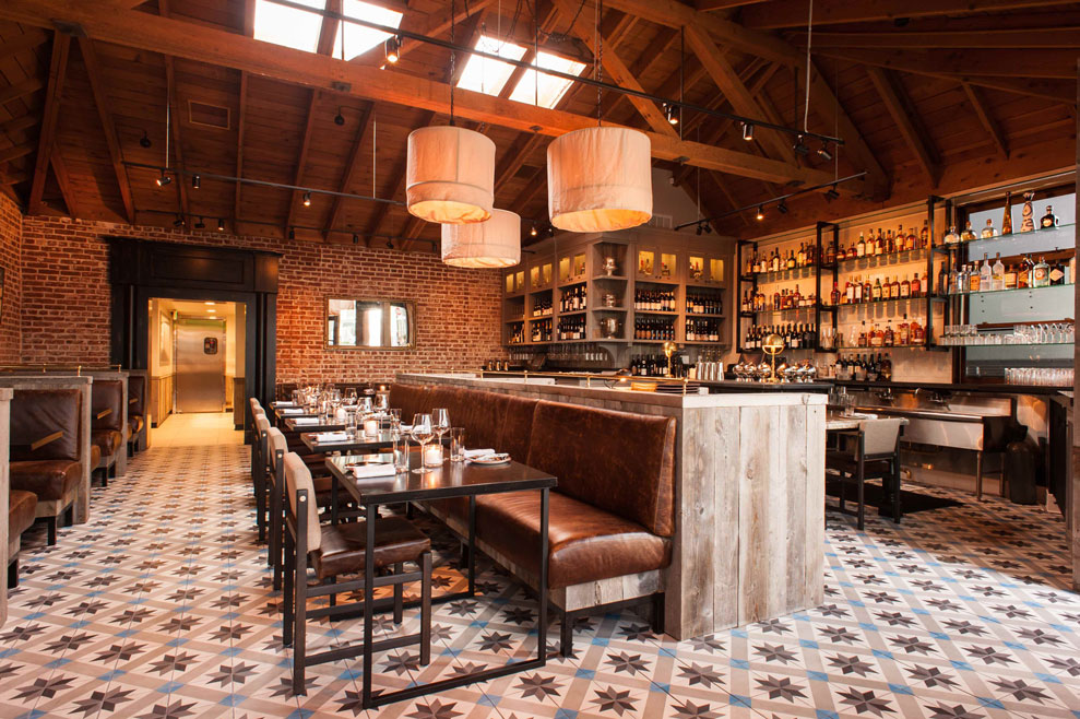 Warm brick walled, tiled restaurant space