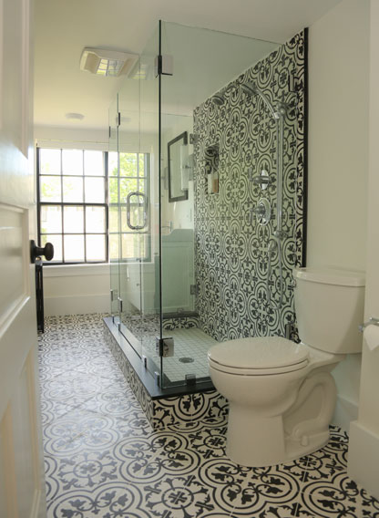 Dramatic bathroom with black and white patterned cement tile by Granada Tile
