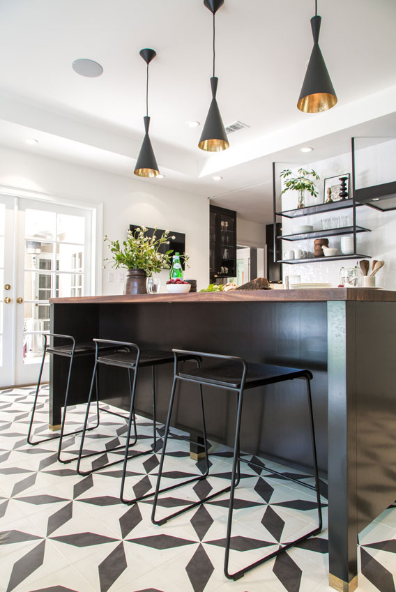 Breakfast bar in modern kitchen with elongated black and white diamond cement tiles