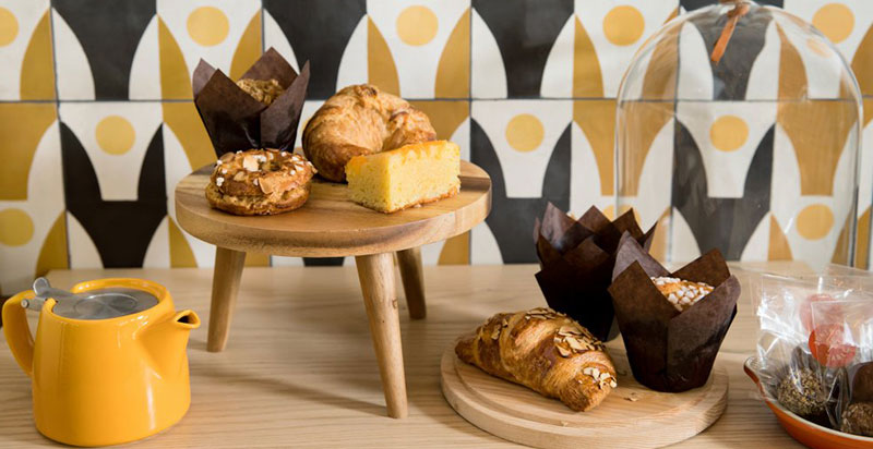 Plates of delicious pastries posed against a backdrop of playful cement tiles