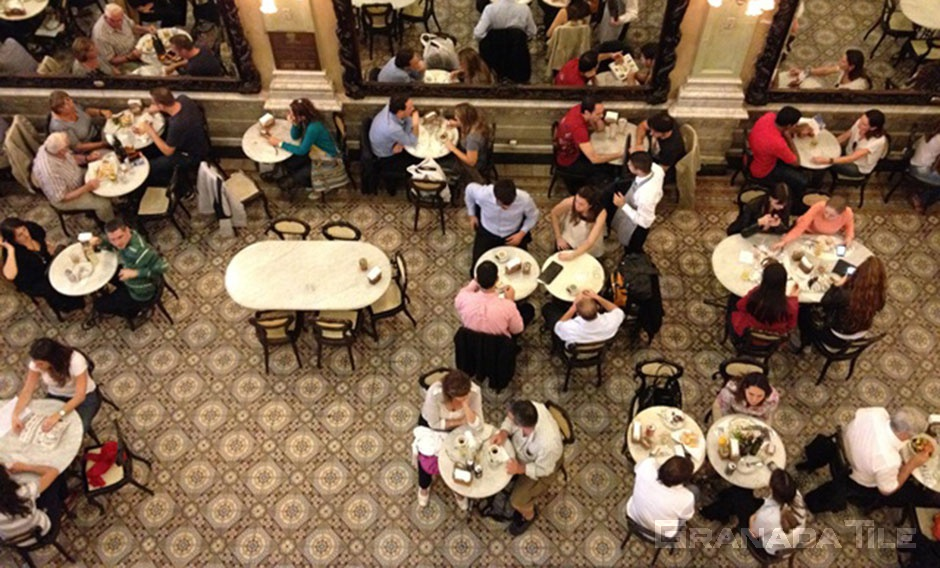 A birds-eye view reveals delicious cement tiles at Confeitaria Colombo, a historic patisserie in Rio de Janeiro.
