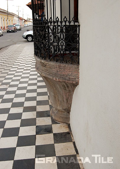 Classic checkerboard concrete tiles for sidewalk