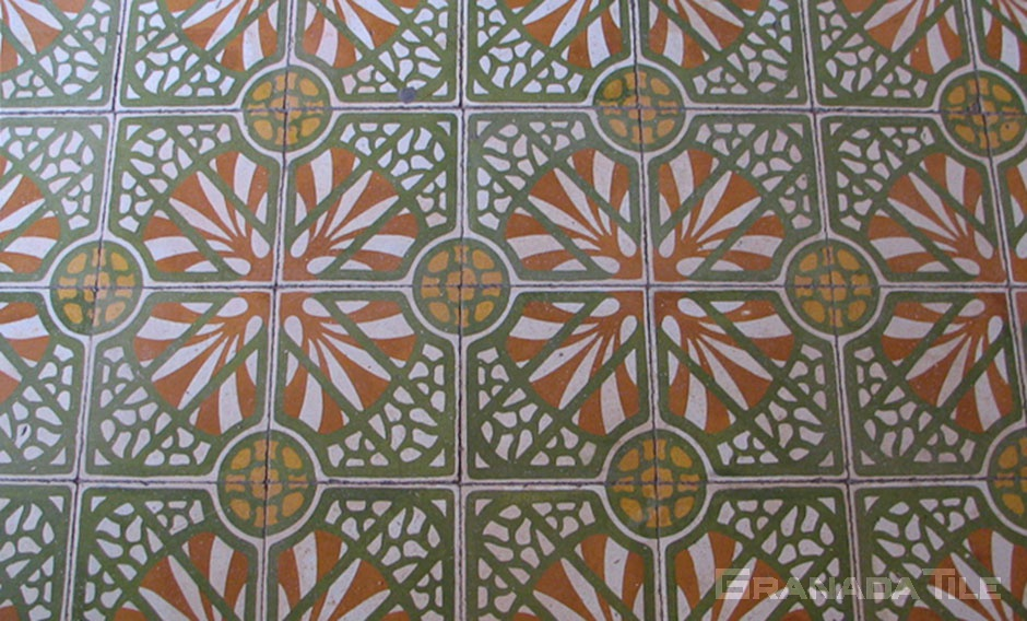 An organic circular floral pattern in green, orange and white for Moroccan encaustic tile floor