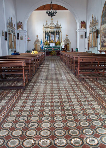 Vast carpet of historic cement tile in a Guatemalan church