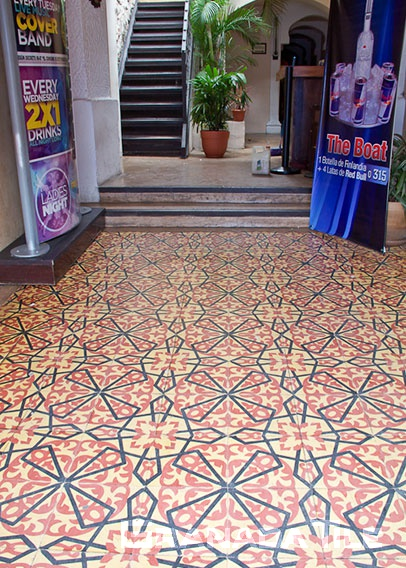 Encaustic cement tile floors in a theater