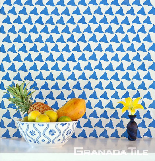 Granada Tile company's Minis Collection Kite tile in blue and white makes this kitchen wall joyful and vibrant