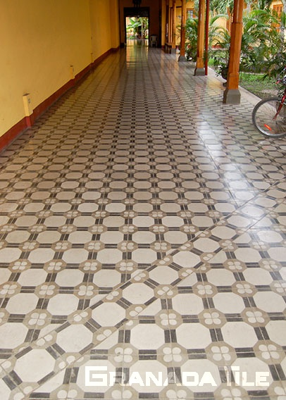 Playful octagon cement tiles design in hallway floor