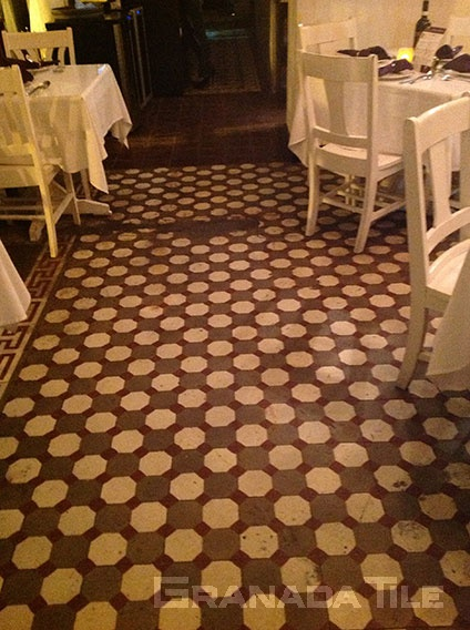 Chic octagons and squares in cement tile design with burgundy, cream and coffee in a restaurant in Casco Viejo, Panama