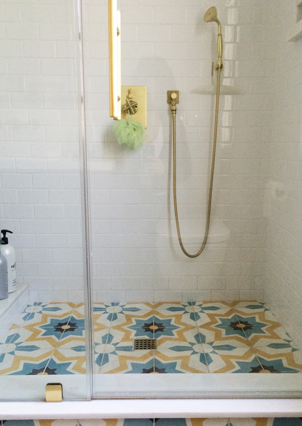 Estrella Cement Tiles In A Custom Color Combination Cover The Bathroom  Floor And Continue Into The Floor Of The Shower Stall, Giving This Compact  Bathroom ...